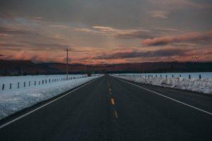 sunrise on a road snow crater lake oregon