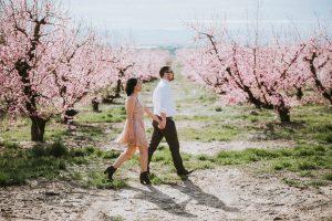 Cute couple engagement poses cherry blossoms boise engagement photographer