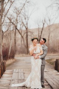 Cute couple first look winter wedding pictures Barber Park Event Center Boise Idaho Wedding photographer