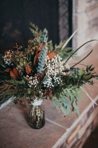 Winter greenery wedding bouquet winter wedding pictures Barber Park Event Center Boise Idaho Wedding photographer